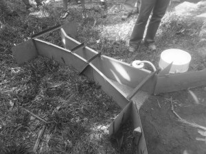 Researchers at South Jonhstone banana research center use a Parshall flume for assessing improved land management on banana farms.